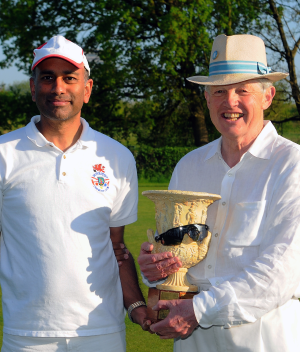 Picture: Chris Roberts - Peter Spiller being presented the Surbiton Easter AC Handicap trophy by manager Samir Patel